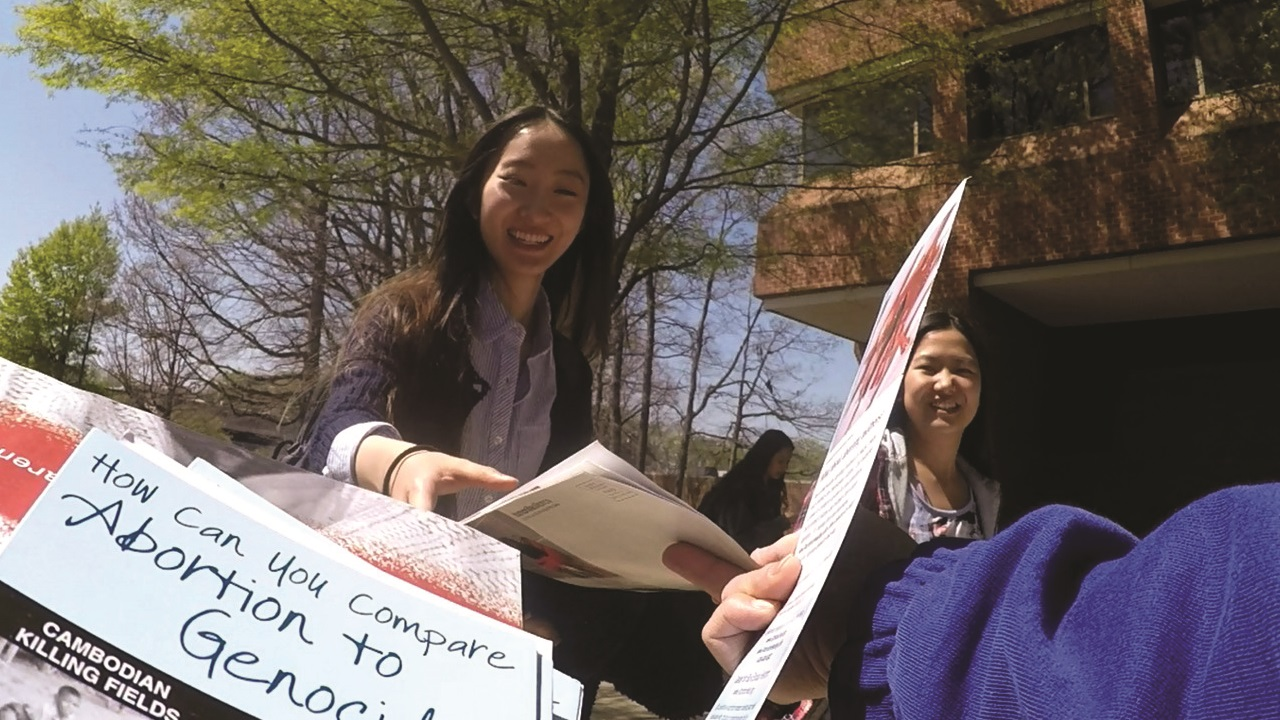 GMU_041416 Students happily receiving pamphlet-1280x720